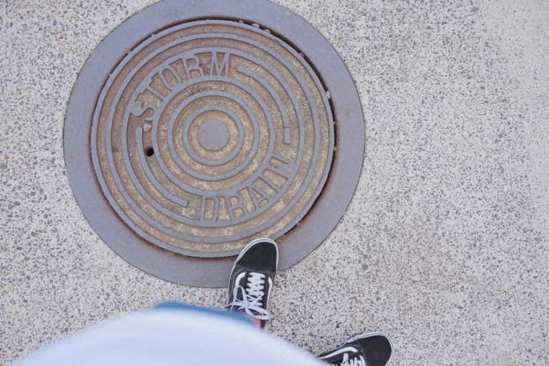 A person standing on a manhole